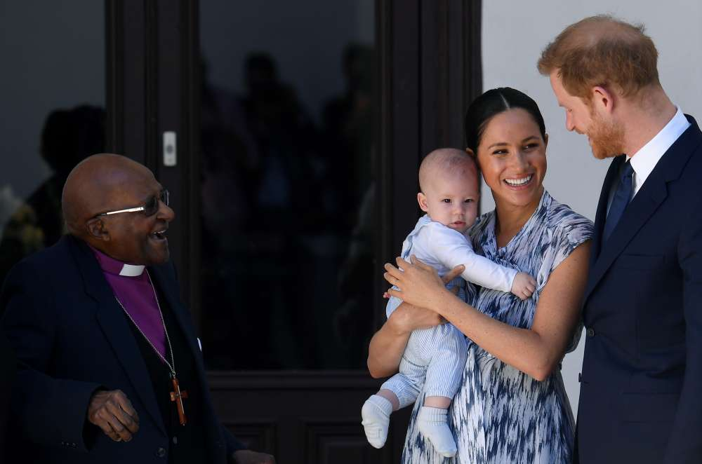 Archbishop Tutu hails Prince Harry and Meghan as caring couple while baby Archie beams (photos)