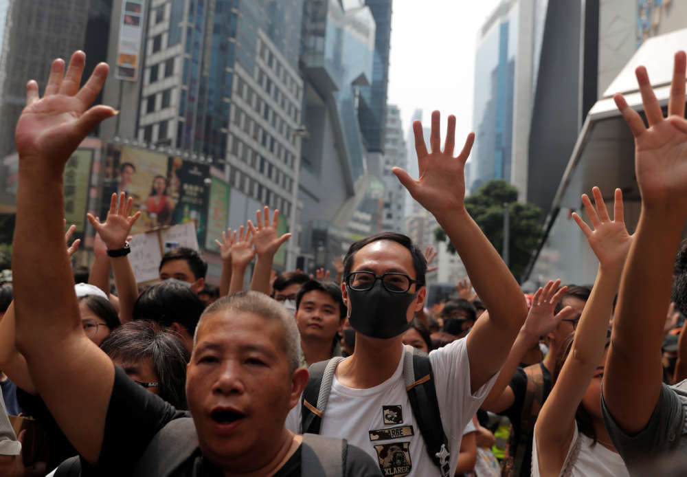 Scuffles break out at Hong Kong protest taking aim at Chinese traders