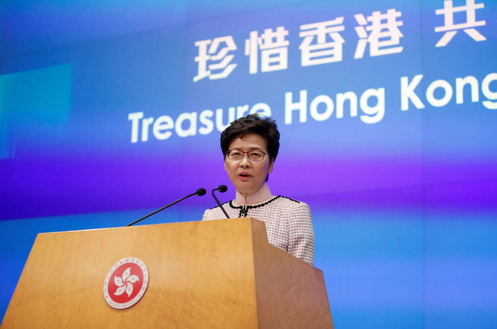 Hong Kong leader forced to abandon address