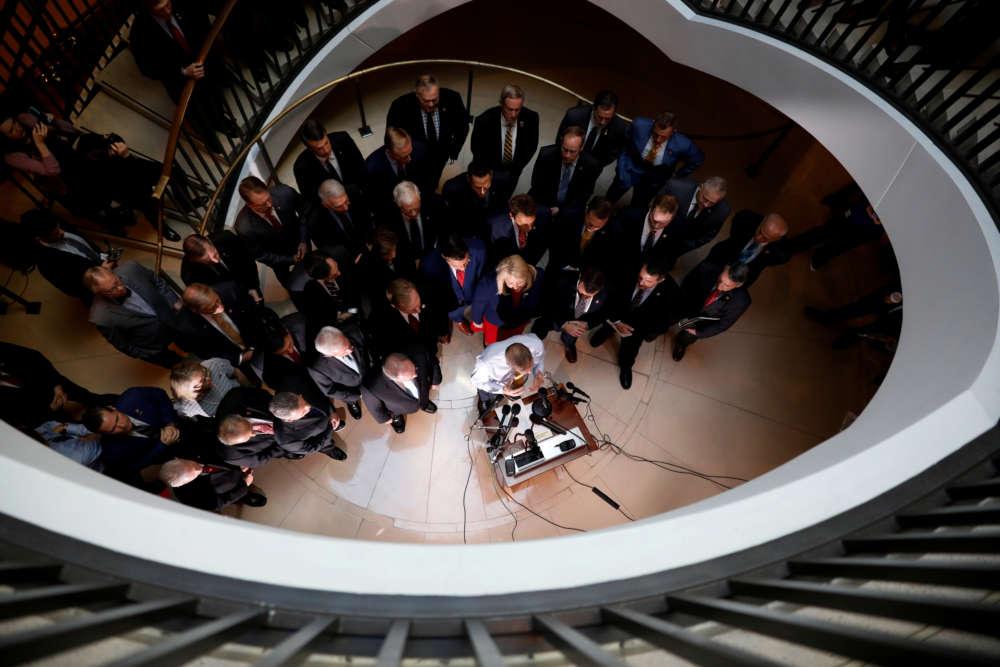 Republican lawmakers storm hearing room