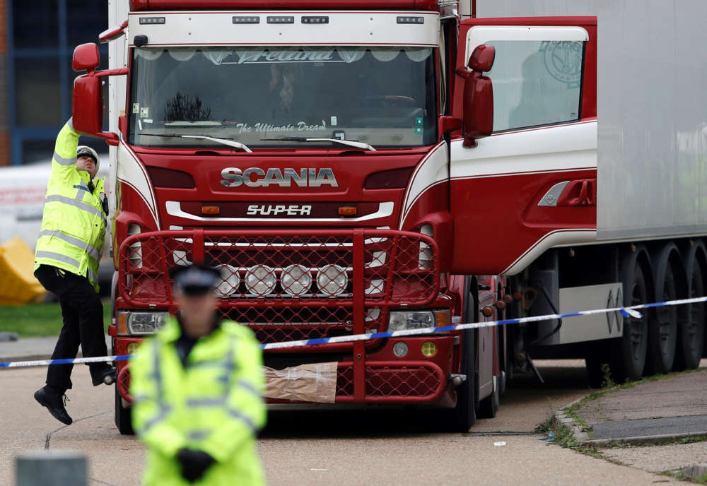 UK police investigating 39 lorry deaths raid two addresses