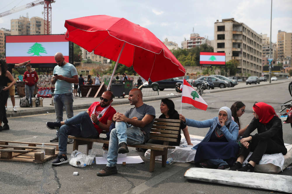 Lebanon's closed banks pledge to pay out salaries