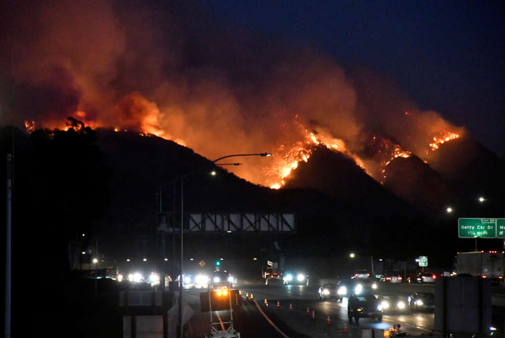 Fire threatens posh L.A. homes as blaze in California wine country rages on