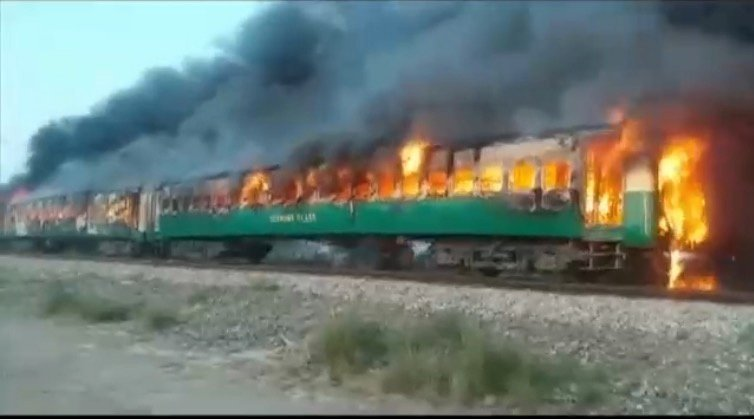 Fire engulfs Pakistani train after cooking accident; 64 dead