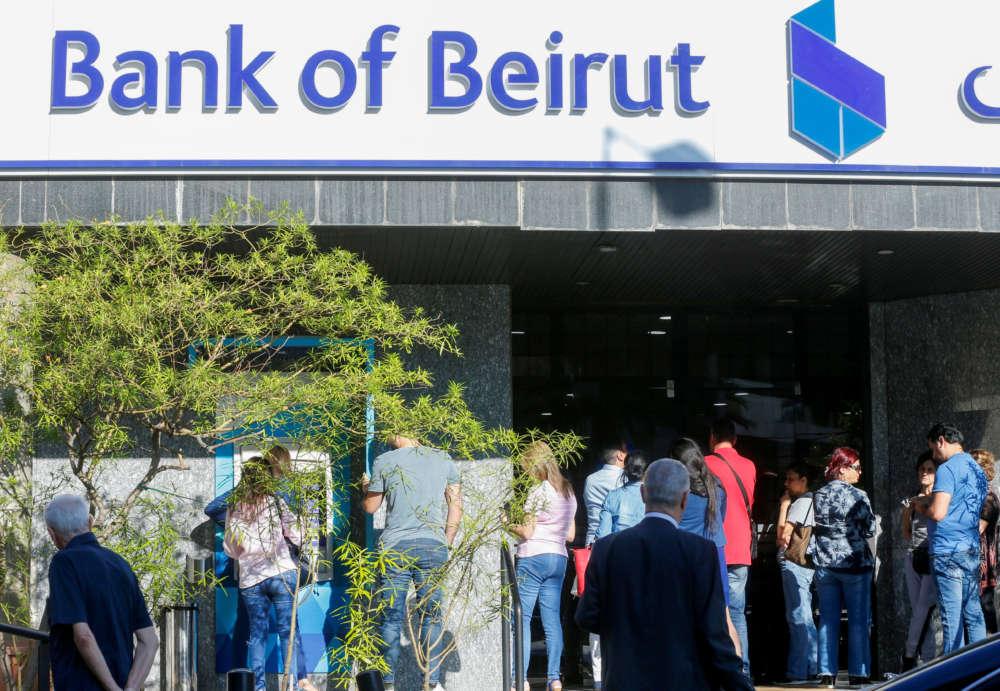 Queues but no panic as Lebanese banks re-open after 2-week hiatus