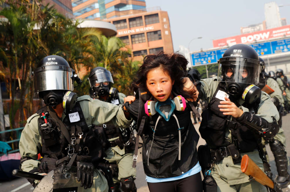 Hong Kong police fire rubber bullets to pin back campus protesters