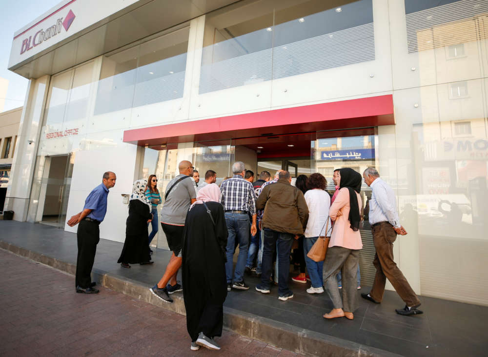 Queues build at Lebanese banks reopening after one-week closure