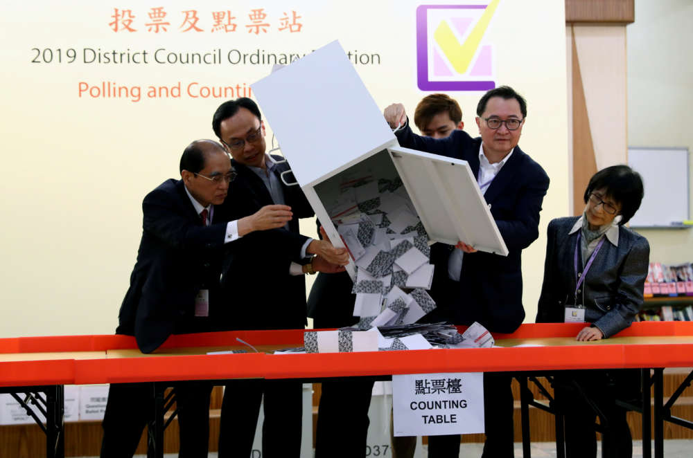 Landslide democratic win puts pressure on Hong Kong leader