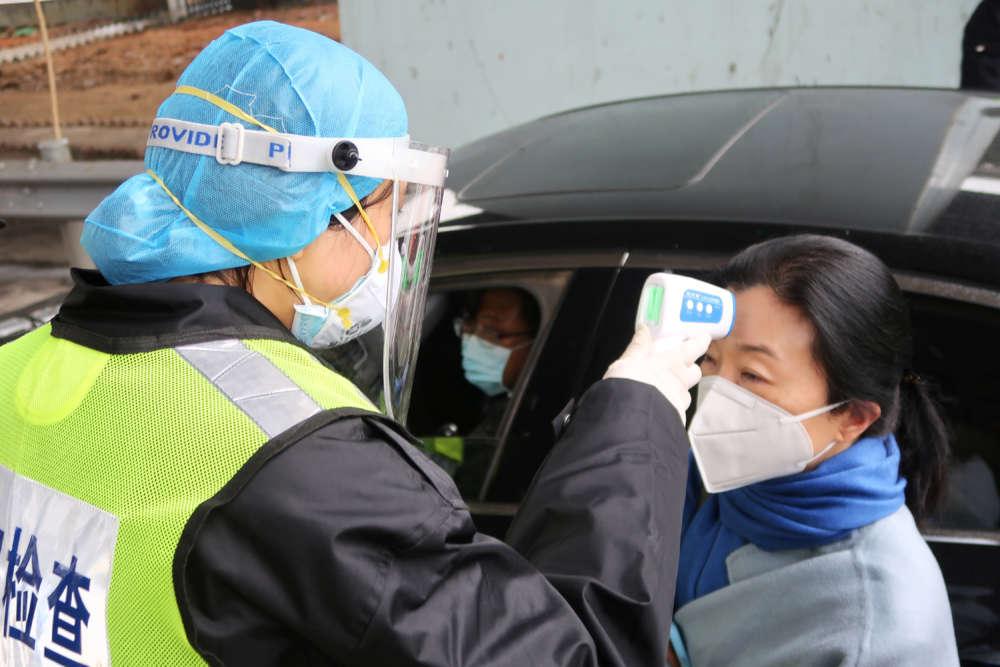 China shuts part of Great Wall as virus toll hits 26