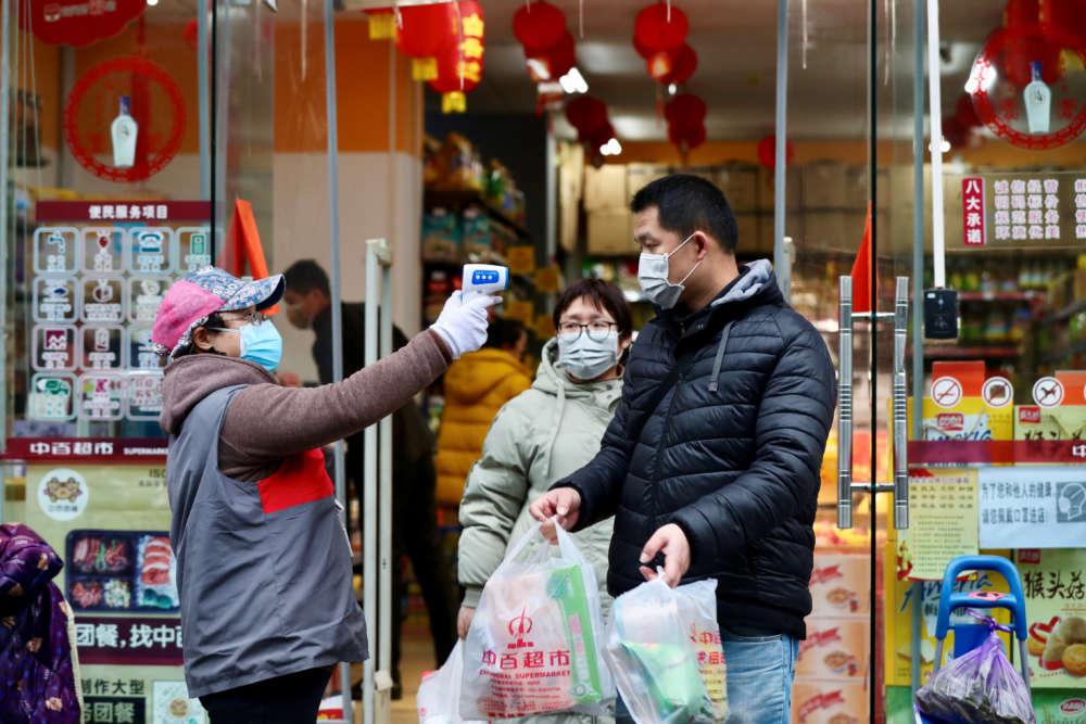 New Chinese coronavirus cases show slight fall