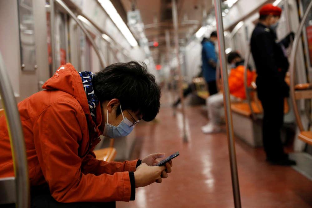 China slowly returns to work as coronavirus toll hits daily record