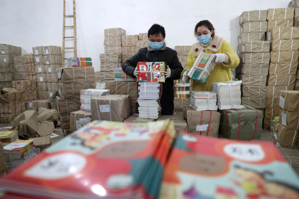 Coronavirus infections slow in China as global economic impact spreads