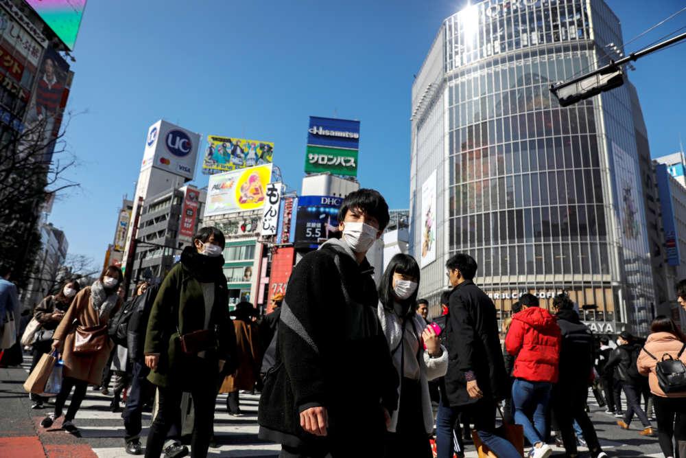 Japan's Abe prepares steps to soften blow of school closures as virus spreads