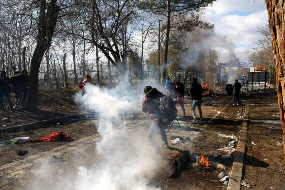 Greek police fire teargas on migrants at border with Turkey