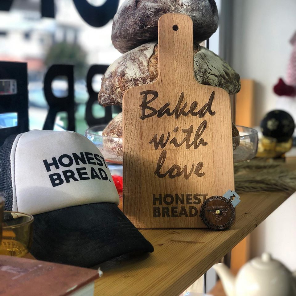 Image may contain: one or more people, text that says 'Baked with love HONES BREAD HONEST BREAD'