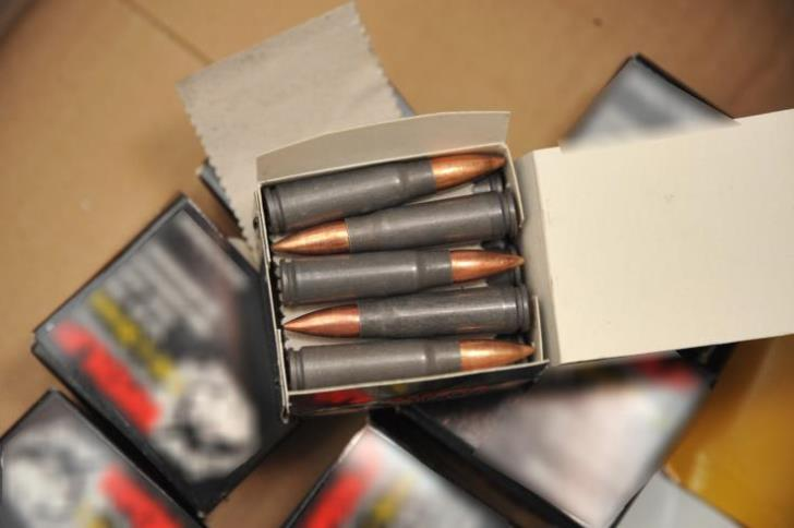 Two men arrested on suspicion of possessing explosives and ammunition