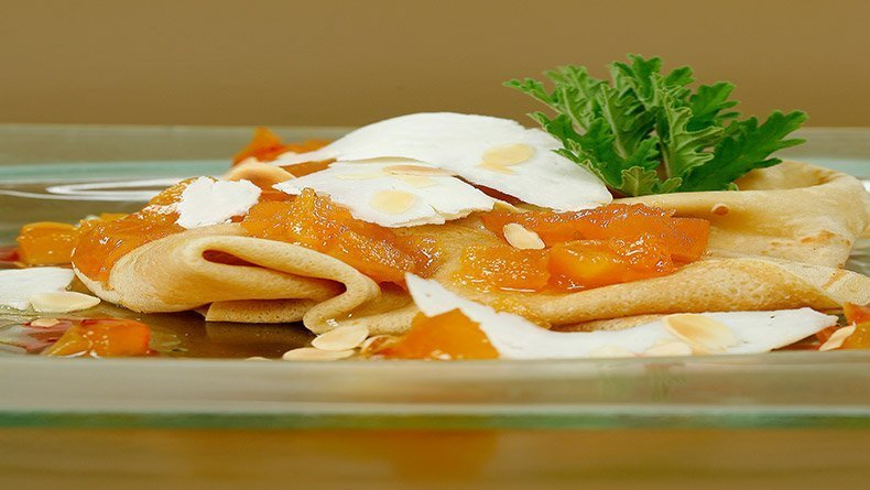 Crepes with apricot spoon sweet and halloumi