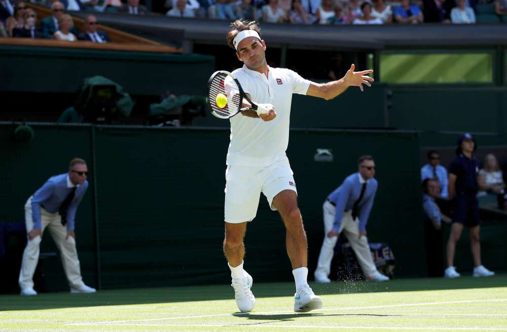 Federer walks out at Wimbledon in Uniqlo shirt