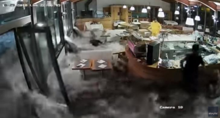 Wave crashes through restaurant windows in Italy as storms continue (video)