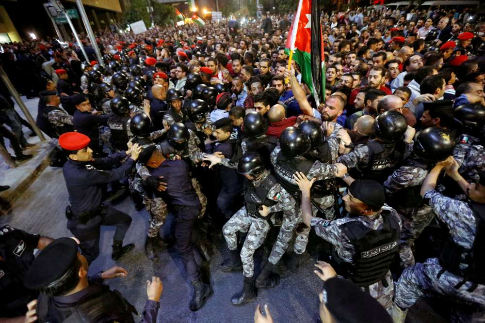 Jordan's king replaces PM to subdue protests