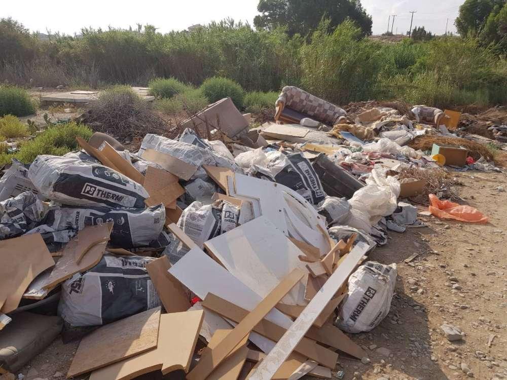 Greens protest refuse pile-up in Nicosia stream