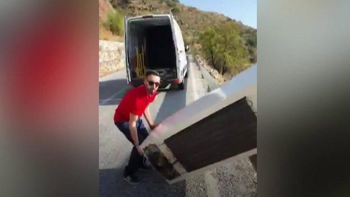 Man throws fridge off cliff