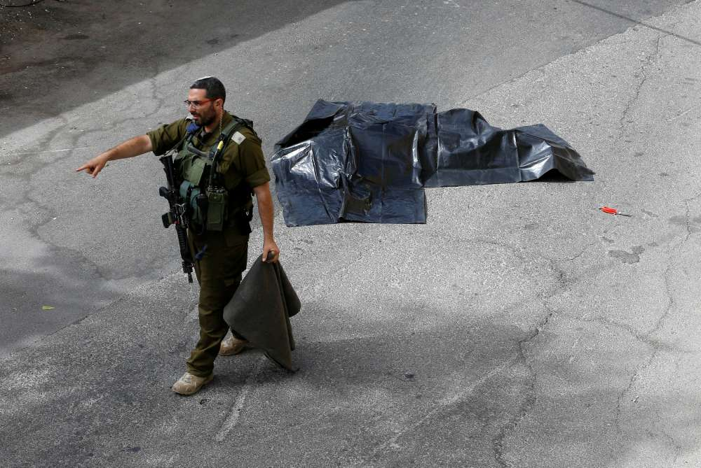 Palestinian stabs Israeli soldier and is shot dead - military