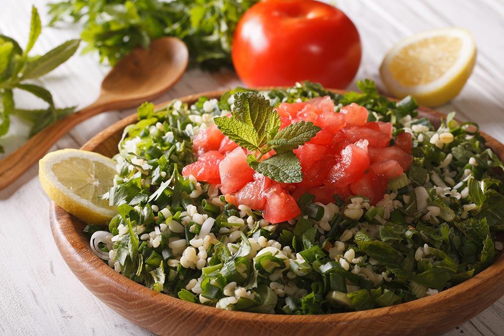 Lebane food. Tabbouleh - lebanese-arabic food, salad with garlic and tomato.