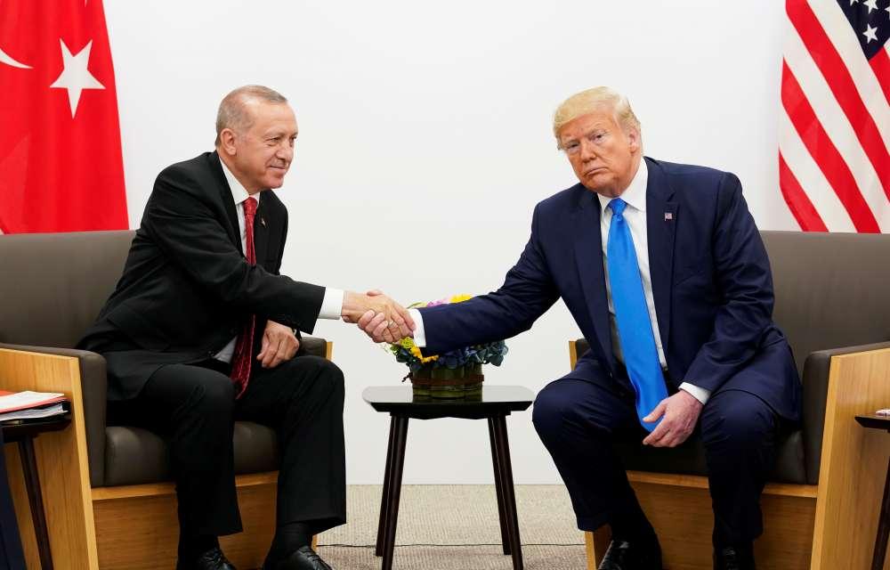 Turkey's Erdogan discusses Syria 'safe zone' in phone call with Trump