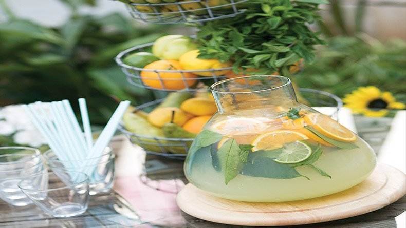 Welcoming drink with fruits and fresh mint