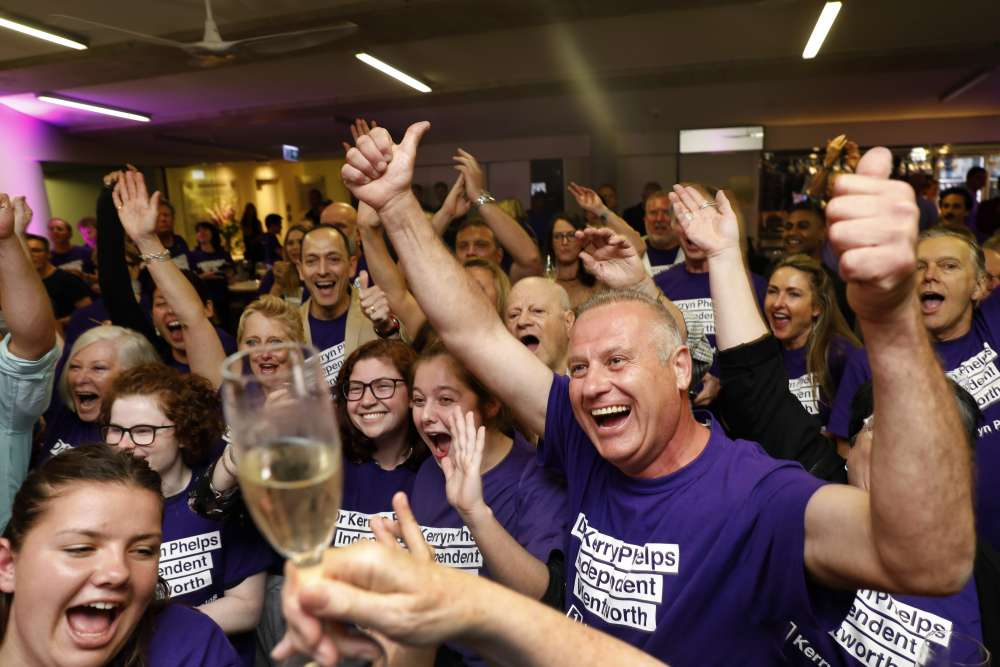 Australia government stripped of majority after by-election rout