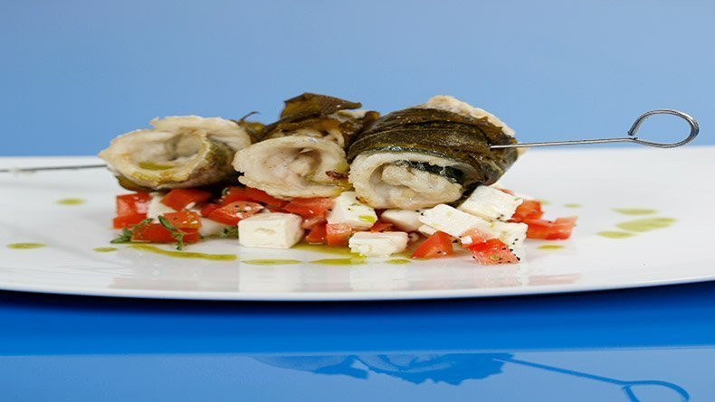 Sea bass in vine leaves