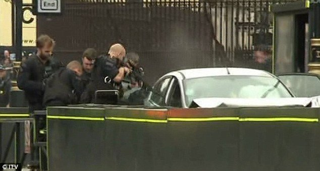 Pedestrians hurt when car smashes into barriers outside UK parliament