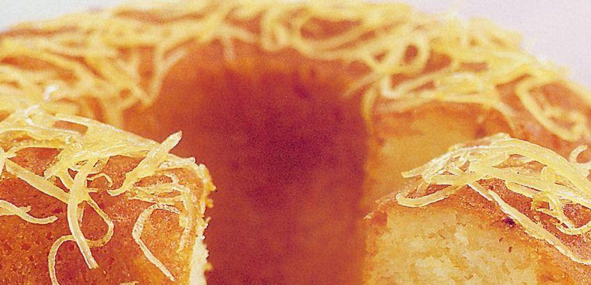 Yogurt cake with almonds and honey syrup