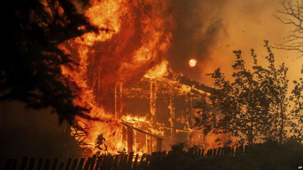 Seventh person dies as northern California wildfires spread