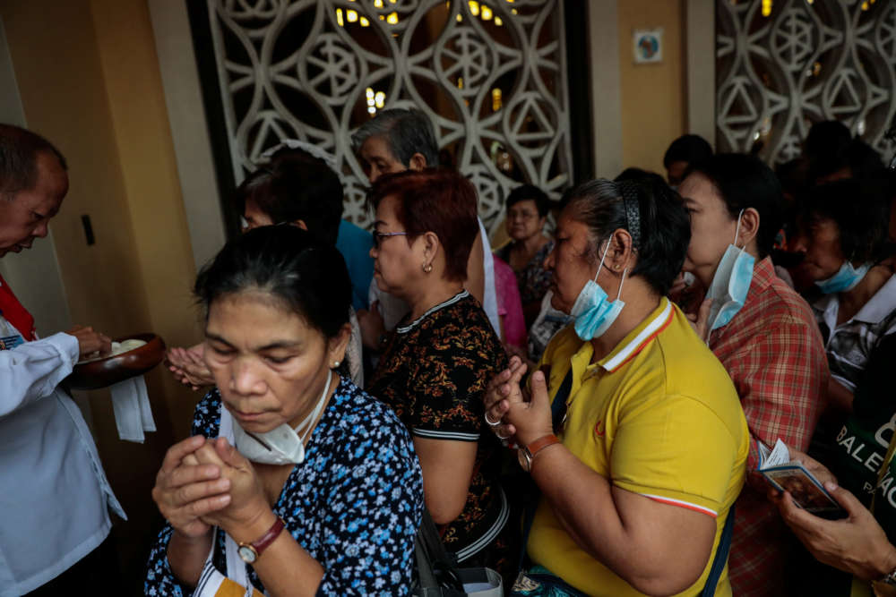 Coronavirus fears lead Holy Land Catholic churches to give communion by hand only