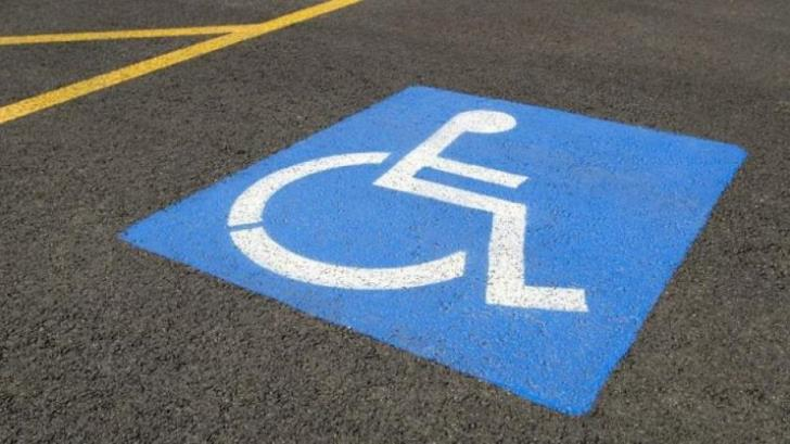 Who is allowed to park in a spot for the disabled?