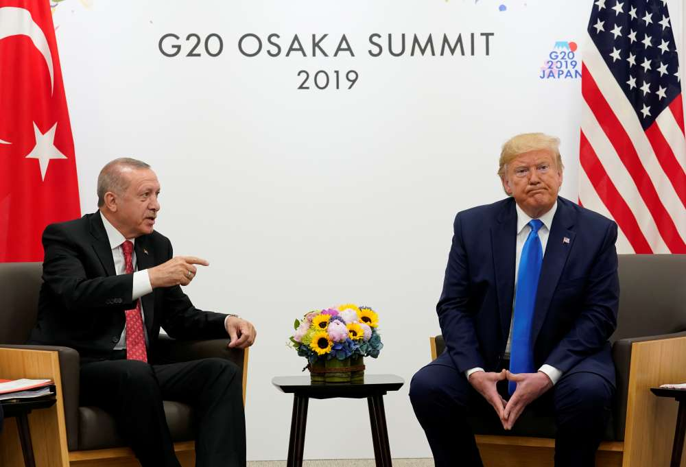 Erdogan says no setback in missile deal with Russia; as Trump voices sympathy