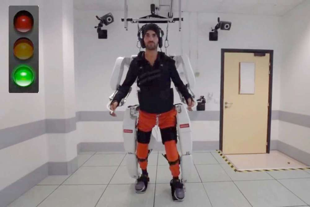 Paralysed man walks again with brain-controlled exoskeleton (video)