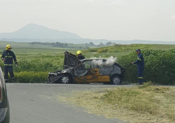 Car on fire after road accident