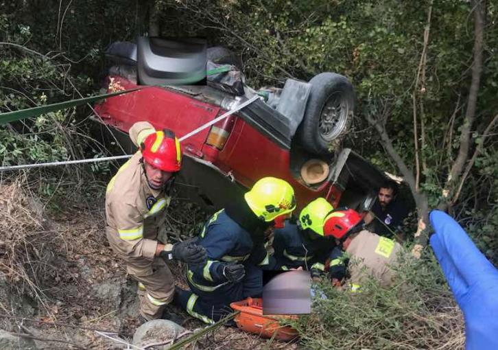 Fire service mount rescue operation after car falls down cliff (photos)