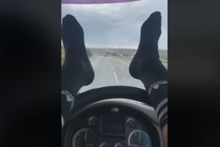 Police slam driver using feet to steer car