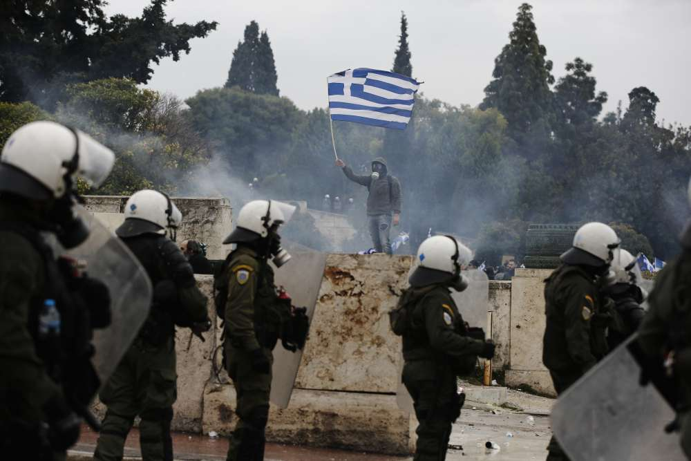 Police fire tear gas as Greeks protest against Macedonia name deal