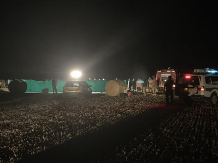 Cause of death still unclear after discovery of burned man in hay bale