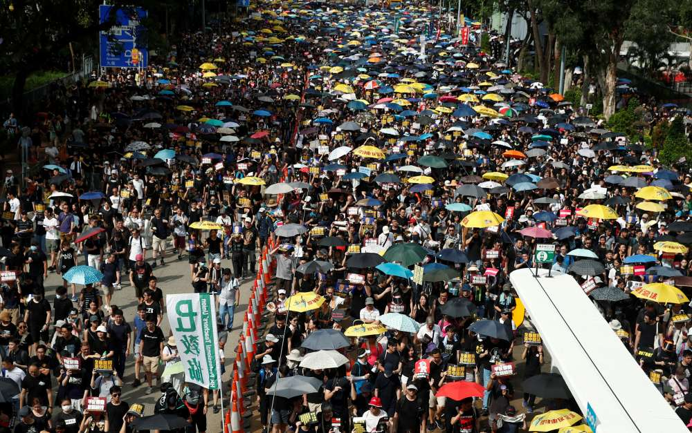 Hong Kong's black-clad protesters target Beijing's representative office