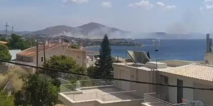 Fire threatening homes in coastal town near Athens contained