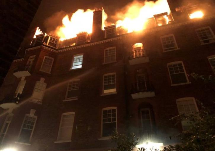 Firefighters tackle blaze in London's West Hampstead flat