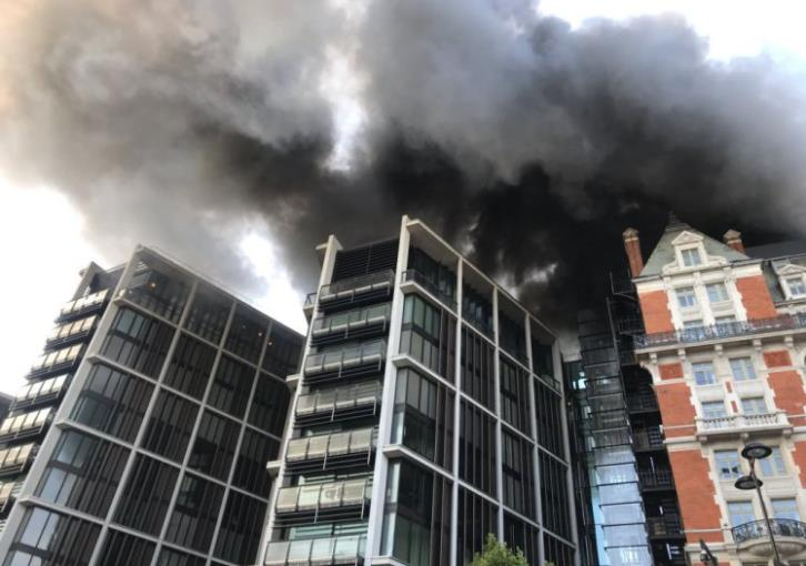 Scores of fighters battling London fire