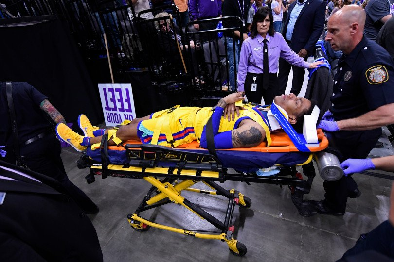Golden State Warriors guard Patrick McCaw wheeled off on stretcher after scary fall