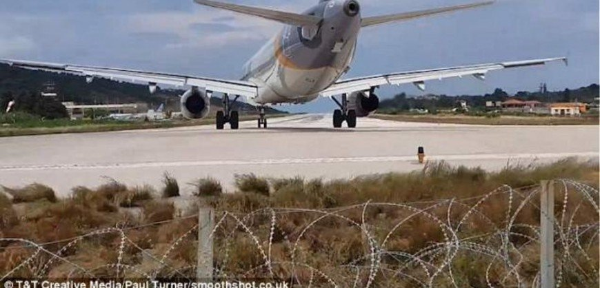 Incredible moment tourist is blown off the ground at Skiathos airport! (video)
